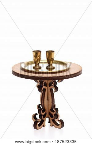 Goblets On Golden Tray And Table Isolated On White