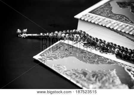 Koran - holy book of Muslimsblack and white style