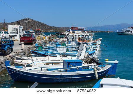 CRETE GREECE - JULY 11 2016: The embankment of a small elite tourist town - Elounda municipality of Agios Nikolaos.