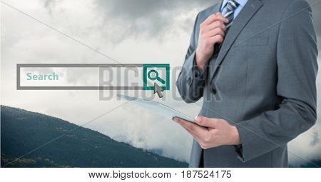 Digital composite of Midsection of businessman holding tablet PC with search screen in background