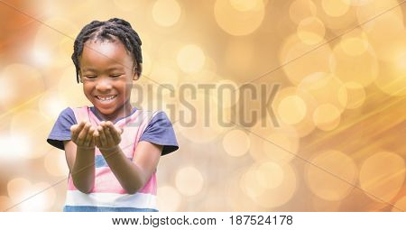 Digital composite of Happy girl looking at cupped hands over bokeh