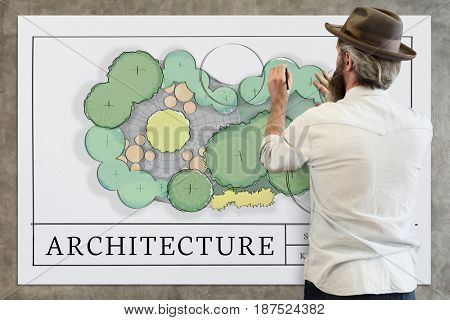 Man working on white board network graphic overlay