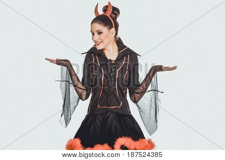 Woman in devil costume with empty hands.