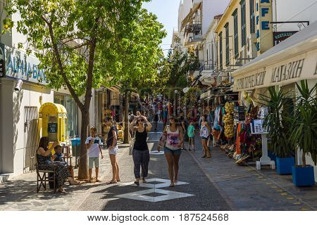 CRETE GREECE - JULY 11 2016: The narrow shopping streets of a coastal elite tourist town Agios Nikolaos on the Greek island of Crete.