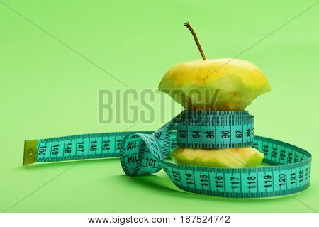 Apple Wrapped By Blue Measure Tape