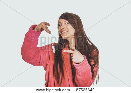 Woman in pink bathrobe with tampon.