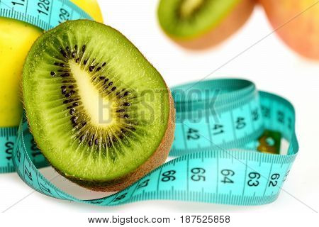 Kiwi Fruit Placed On Light Blue Measure Tape