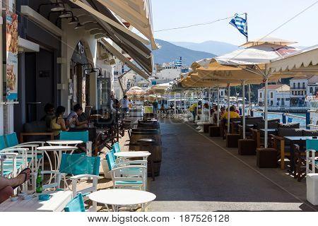 CRETE GREECE - JULY 11 2016: Cafes on the embankment of a coastal elite tourist town Agios Nikolaos on the Greek island of Crete.