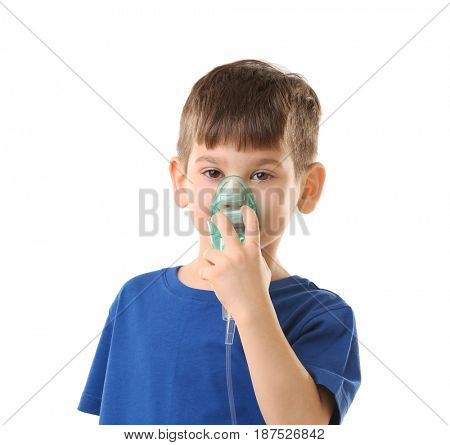 Cute little boy using nebulizer on white background. Allergy concept