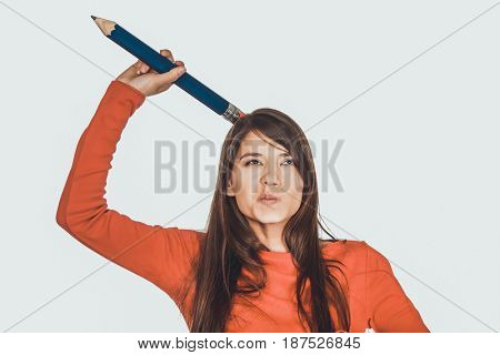Beautiful young with a big pencil on head.