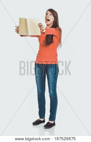 Shocked student woman with her note.
