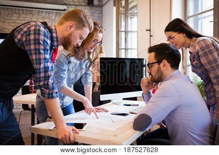 Business Coworkers and architects working on project together in office