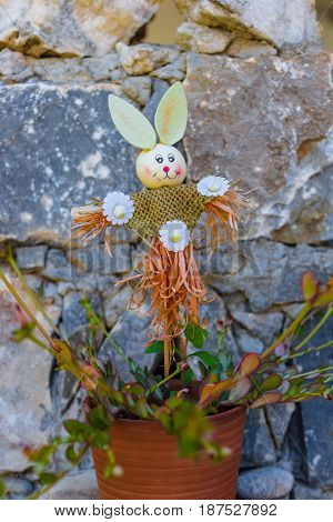 CRETE GREECE - JULY 14 2016: Cute toy in the form of a scarecrow in a flower pot. Handmade.