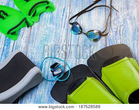 Accessories For Sports Swimming On  Wooden Background Sunshine.