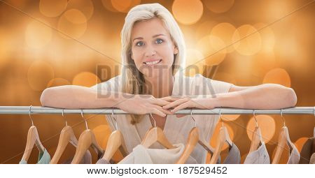 Digital composite of Woman leaning on clothing rack
