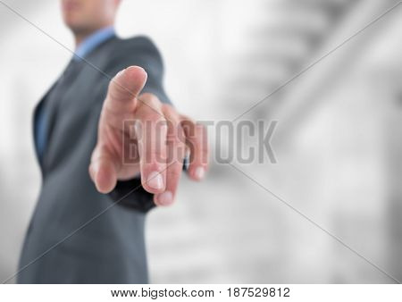 Digital composite of Midsection of businessman pointing
