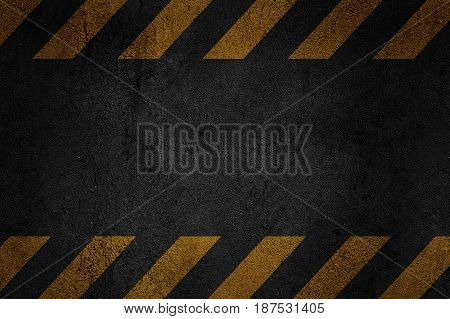 Old black grungy metal plate surface with yellow warning stripes. Building construction. Banner place for text.