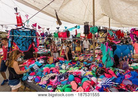 HERAKLION GREECE - JULY 16 2016: Crete. Popular among residents and tourists gypsy market. Sale of swimwear.