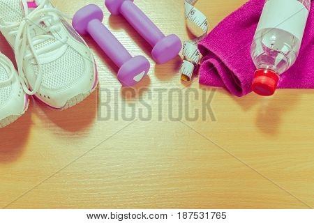 Shoes and sports equipment on wooden floor top view