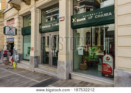 HERAKLION GREECE - JULY 16 2016: Branch of Bank of Chania on the main tourist street. Co-operative Bank of Chania is a local bank of Crete.