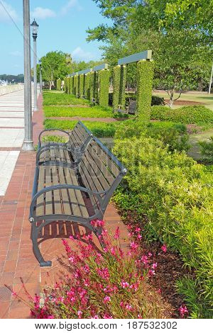 Benches and swings at the promenade of the Henry C. Chambers Waterfront Park located south of Bay Street in the Historic District of downtown Beaufort South Carolina vertical