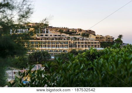 AGIA PELAGIA GREECE - JULY 16 2016: Crete. Village Mononaftis. The popular five-star hotel Sea Side Resort on the hillside. Evening. Twilight.