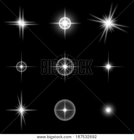 Set of the realistic beautiful white star fires and flashes on a black background. Vector illustration. It is possible to use on transparent and any background.