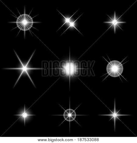 Set of the realistic sparkling white star fires and flashes on a black background. Vector illustration. It is possible to use on transparent and any background.