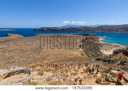 CRETE GREECE - JULY 18 2016: Rise to the ancient Venetian fortress. Natural landscape of the island Imeri Gramvousa. Mediterranean Sea.