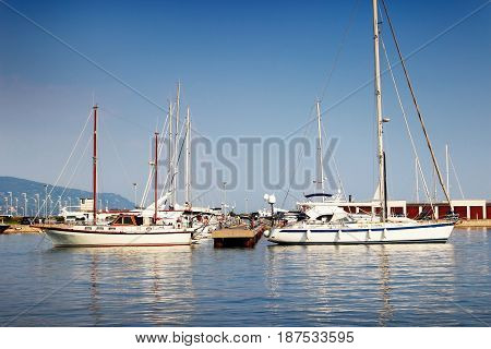 Many white yachts in sea port in summer.