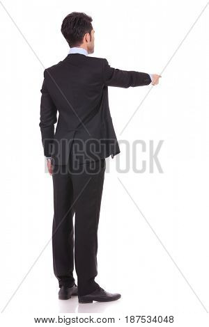 back view of a businessman pointing finger on white background
