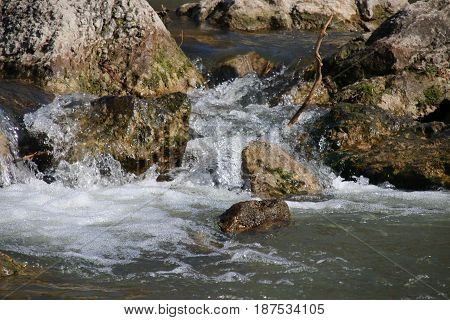 Close-up of cascades and rapids of a fast mountain river