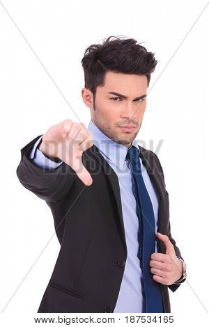 angry business man miking the thumbs down gesture on white background