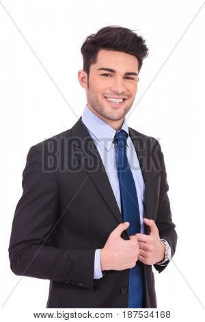 happy young business man holding his collar isolated on white background