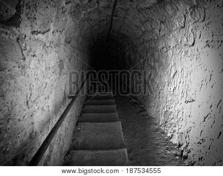 dark steps descending down a passage or tunnel