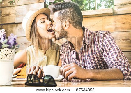 Young fashion couple of lovers at love story beginnings - Pretty woman sexy biting and kissing handsome man nose - Relationship love concept with boyfriend and girlfriend together - Warm retro filter