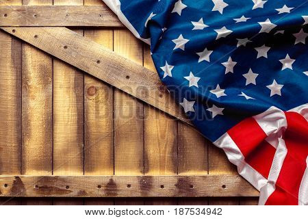 American Flag on wooden table. top view