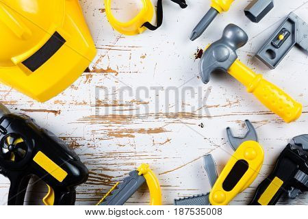 Father's day concept - child tools on wood background, top view