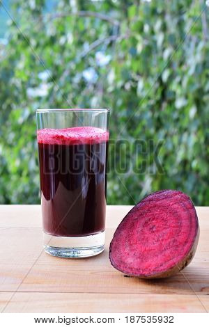 Healthy beet juice freshly pressed in glass