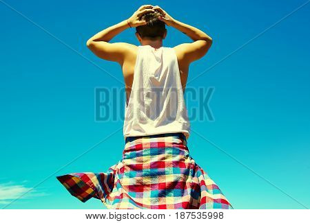 Upset Stylish Man In Casual Hipster Clothes With Big Problems  Touching Head On Blue Sky Background