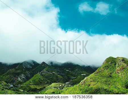 Beautiful View Of Mountain Forest And Blue Sky. Mountain Forest Before Storm With Clouds And Blue Sk