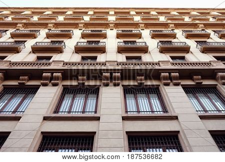 Low angle view of a tall early 20th century building, Barcelona, Spain