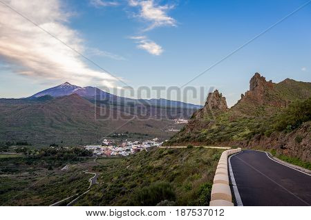 Mountain road, village and Teide national park at late evening. Tenerife island, Canarias, Spain.