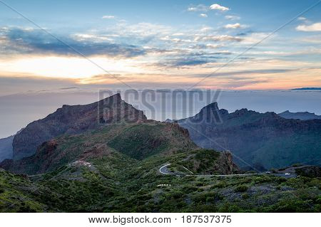Night landscape with mountain road to the popular Masca canyon. Sunset and rocks of volcanic Tenerife island. Canarias, Spain
