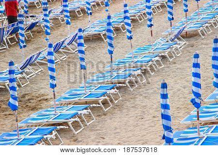 Sun Umbrellas And Sunbeds
