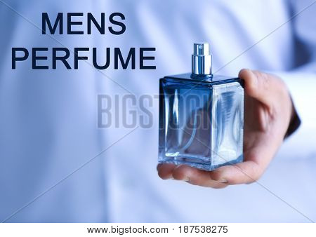 Men's perfume. Man holding bottle of cologne and text on background