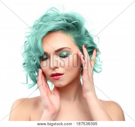 Trendy hairstyle ideas. Young woman with mint hair color on white background