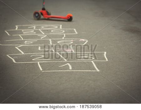 hopscotch game on outdoor playground, kids playtime