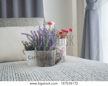 modern vintage sofa and fresh beautiful variety flower on vase at living room concept of natural at home purple lavender flower rose flower Portulaca flower on wood vase.