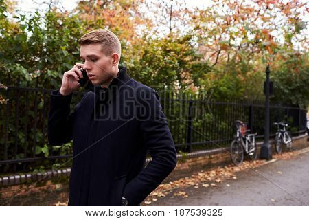 Young Man Talking On Mobile Phone In Oxford Street